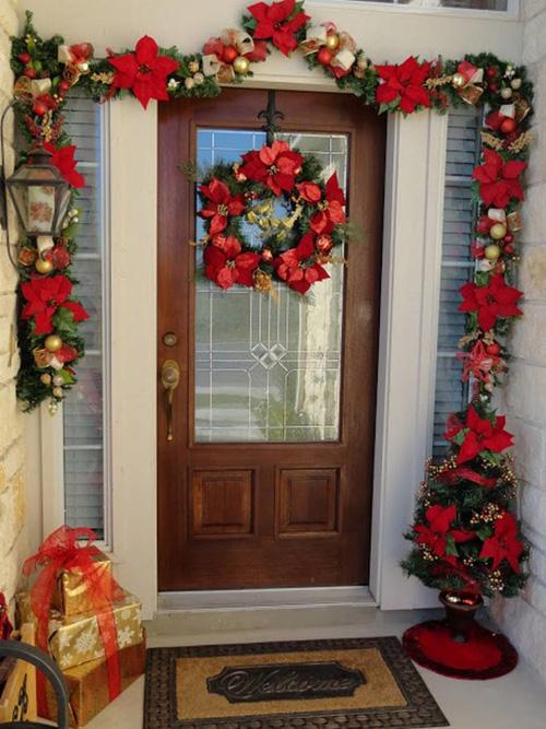 Decoracion de navidad para puertas for Puertas recicladas para decorar